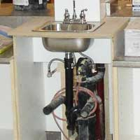 faucet and drain repairs, sink and countertop installation
